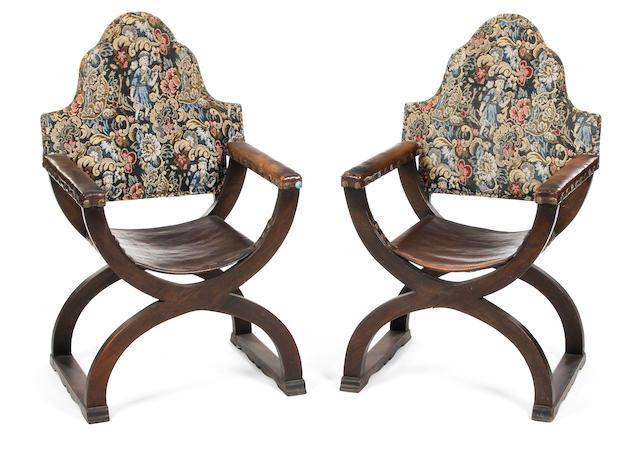 A pair of early 20th Century oak Savonarola chairs