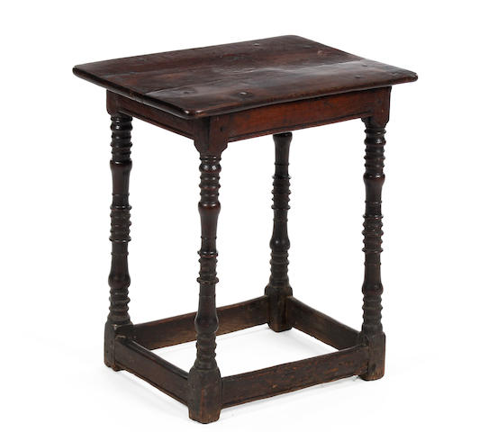 A Charles II small oak centre table