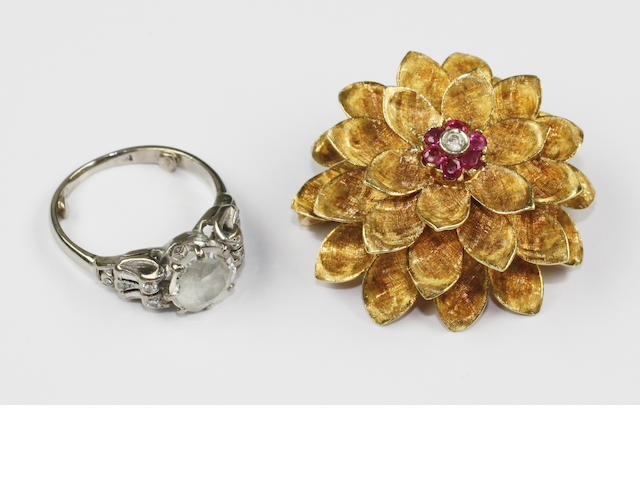 An 18ct gold domed flowerhead brooch (2)