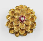 An 18ct gold domed flowerhead brooch, (2)