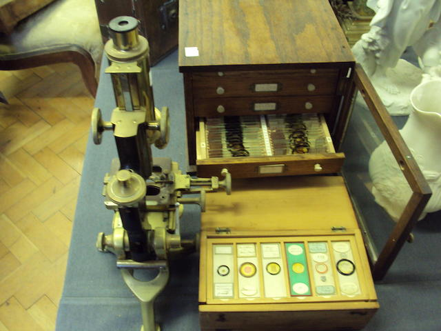A brass microscope with slides