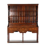 A late George III oak high dresser