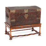A George I leather and brass studded dome trunk, on associated walnut stand