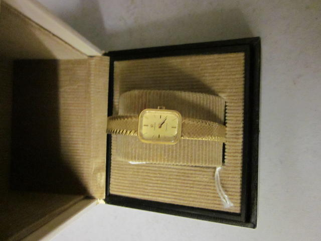 Omega: A lady's 18 carat gold bracelet watch,
