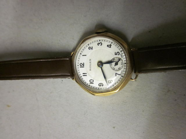 Rolex: A 9 carat gold lady's strap watch,