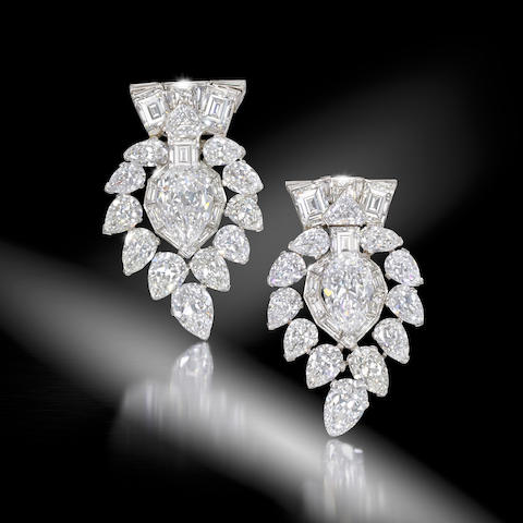 A magnificent pair of diamond clip brooches, by Cartier,  (2)