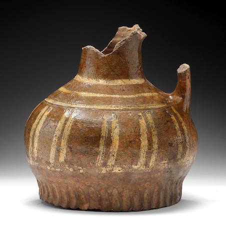 A medieval pottery jug, circa 13th century