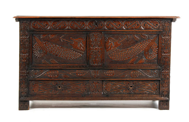A carved oak mule chest