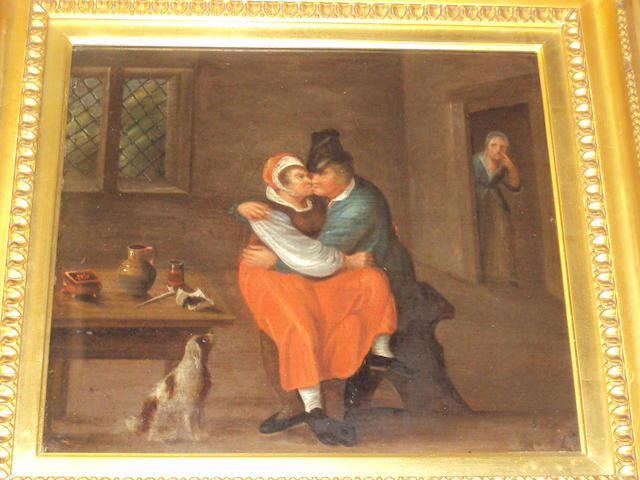 Follower of George Morland (British, 1763-1804) A stolen kiss