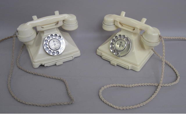 Two 200-series ivory bakelite telephones: impressed marks: 164 55 and 57