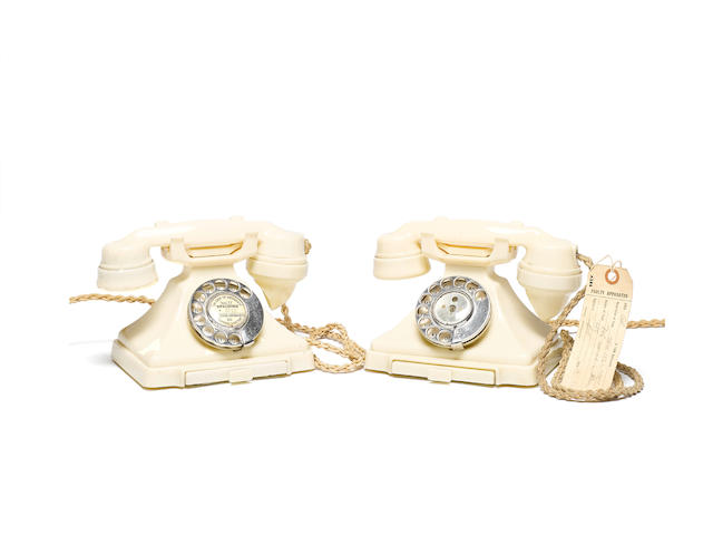 Two 200-series ivory bakelite telephones: impressed marks: 164 52 and 164 55,