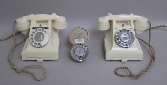 Two type 310 ivory bakelite telephones:  impressed marks: 164 52 and 164 50