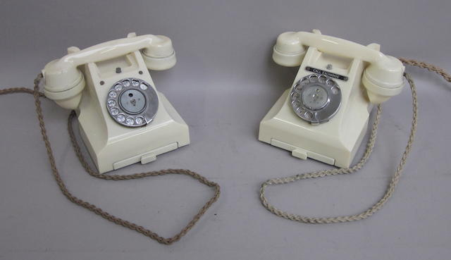 Two type 312 ivory bakelite telephones: impressed marks: E-37 and 164 54