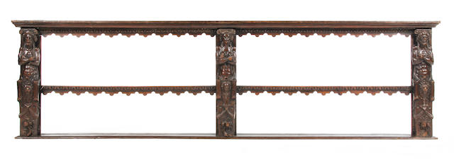 An oak open mural rack, incorporating three 17th Century Low Countries figural terms