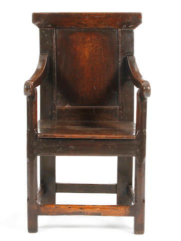 An early 18th Century oak panel back armchair