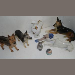 A collection of Beswick, Royal Doulton, Royal Copenhagen and other figures, of dogs and other animals and other items.