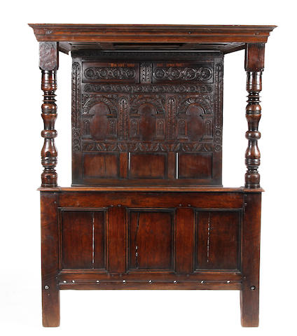 A 17th Century style oak tester bed