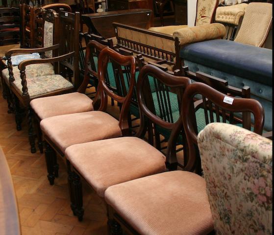 A set of three mid-Victorian mahogany balloon-back dining chairs