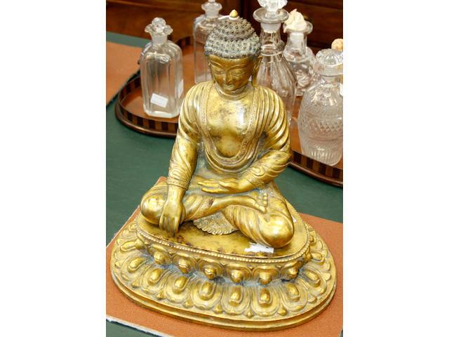 A gilt-bronze seated figure of Buddha