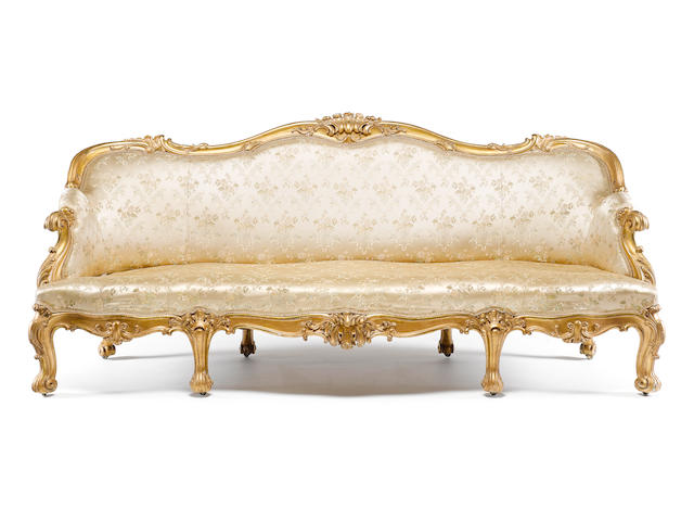 A pair of William IV rococo revival carved giltwood sofas by Gillows