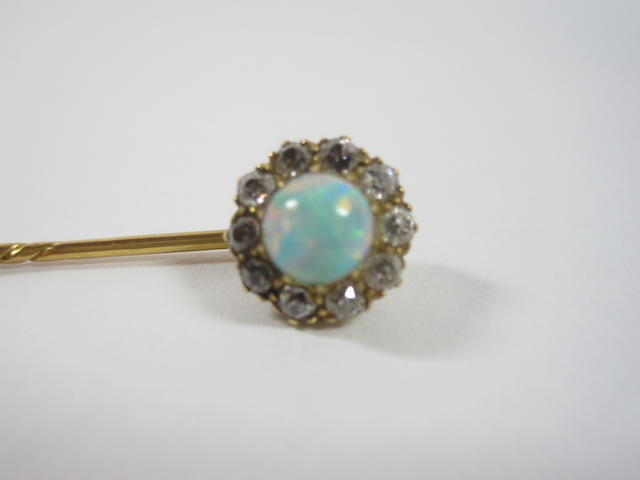 An opal and diamond stick pin