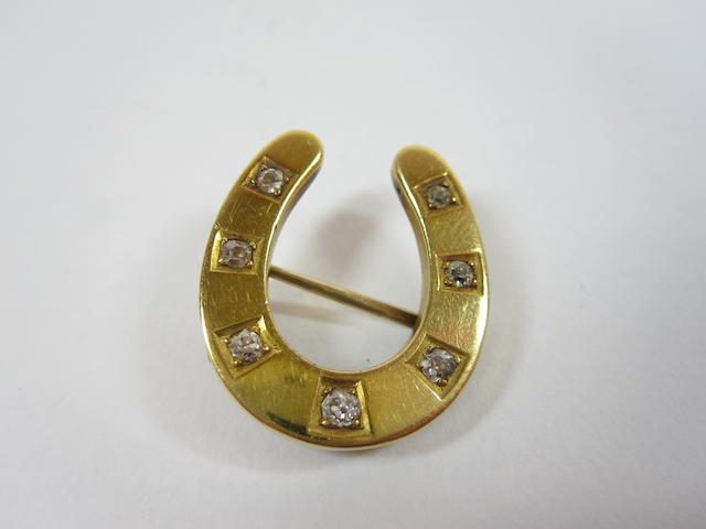 A Victorian diamond-set horseshoe brooch