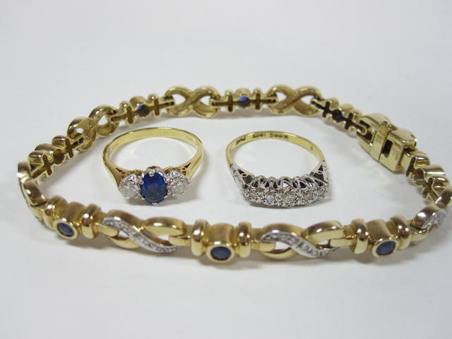 A sapphire and diamond bracelet and two rings