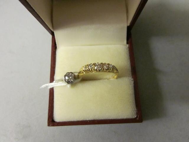 An 18 carat gold five stone diamond ring, (2)