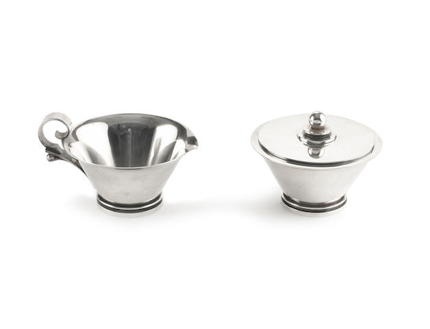 A  Danish silver ####'Pyramid' pattern### milk jug and sugar bowl, by Georg Jensen, with incuse mark for harald Nielsen, incused with model number '600A', the bowl also incused 'A11' and the jug 'R10',  (2)