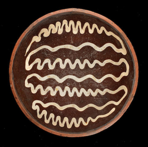 A Staffordshire slipware dish, 18th century