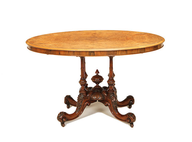 A mid Victorian figured walnut and walnut loo table