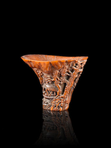 A rhinoceros horn libation cup (damage), wood stands