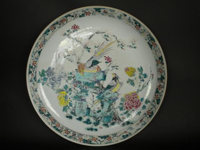 A famille rose plate of circular form Yongzheng or Qianlong