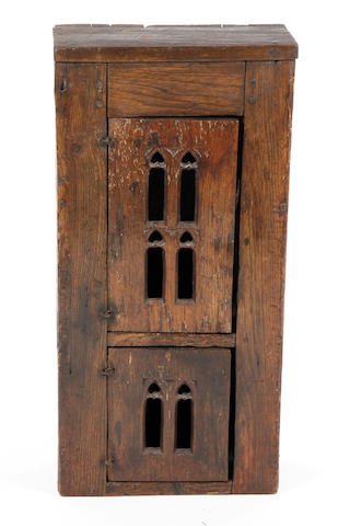 A 16th Century style oak mural cupboard