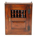 A 17th Century-style oak mural food cupboard