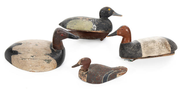 Four various painted wooden decoy ducksAmerican, circa 1900