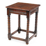 An oak side table Construted in part from Charles II timbers