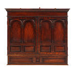 A late 19th century oak mural cupboard Of architectural form