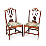 A set of five George III fruitwood dining chairs
