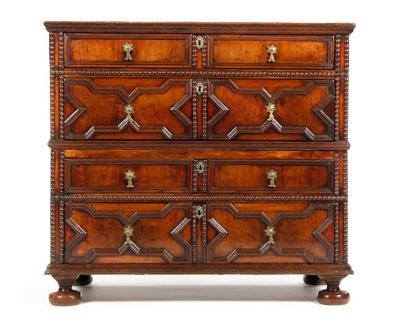 An oak, wlnut and fruitwood geometric chest of drawers, circa 1700