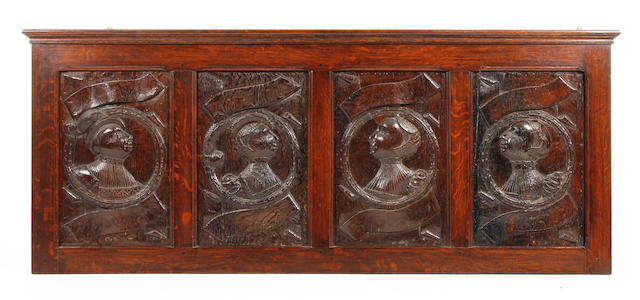 A superb set of four early Elizabethan carved oak 'Romayne' bust portrait panels Circa 1560, probably depicting members of the Stanley Family of Hooton Hall, Wirral