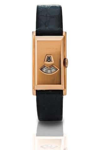 Waltham.  A fine 18ct gold rectangular manual wind wrist watch with jumping hourCase No. 7227449, Circa 1940s
