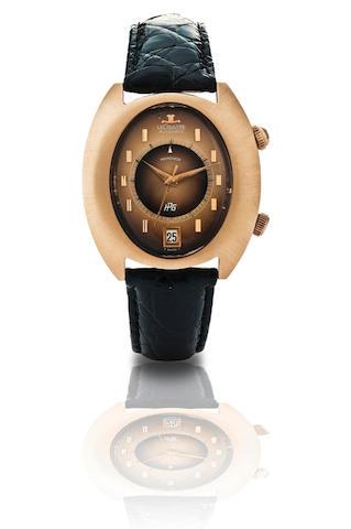 LeCoultre.  A 14ct gold automatic alarm and calendar wristwatch Memovox, Case No. 6751263, Circa 1970s