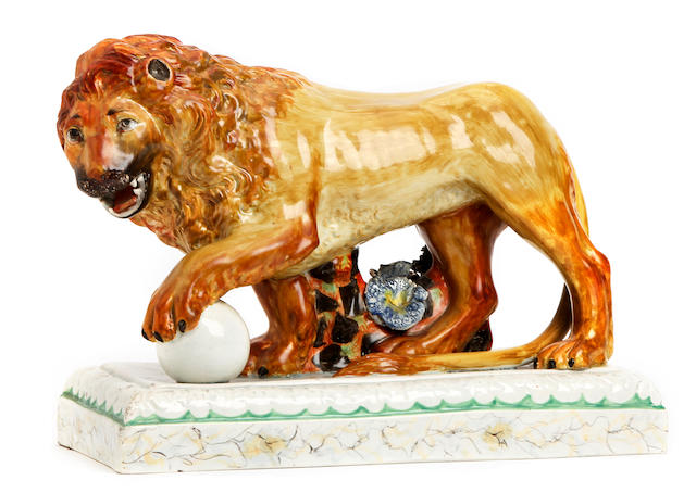 A pearlware figure of a lion