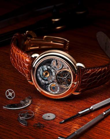 Audemars Piguet. A fine and rare 18ct gold skeletonized bumper automatic tourbillon wristwatch Tourbillon No. 79, Case no. D56708, Circa 1990s