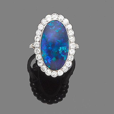 An early 20th century black opal and diamond cluster ring