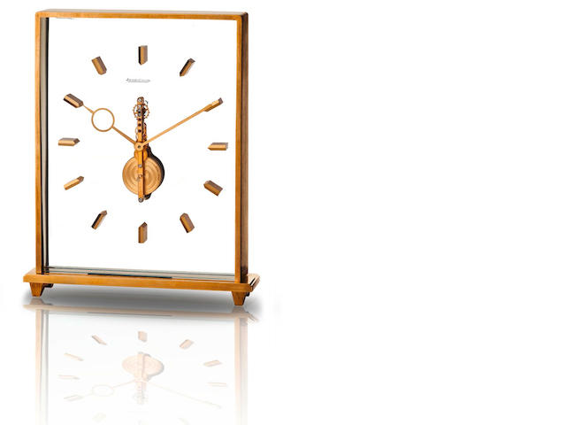 Jaeger LeCoultre. A fine brass skeletonized desk clock  Case no. 22330 355, Circa 1950s