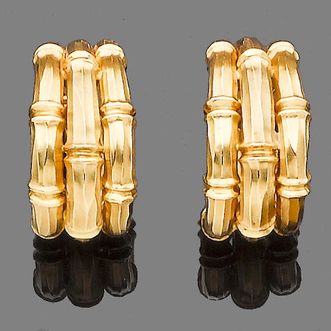 A pair of gold earhoops, by Cartier