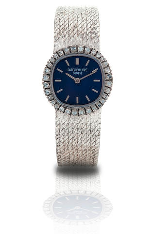Patek Philippe. A fine 18ct white gold diamond ladies manual wind wristwatch  Ref: 4113/1, Case no. 2705398, Circa 1980s