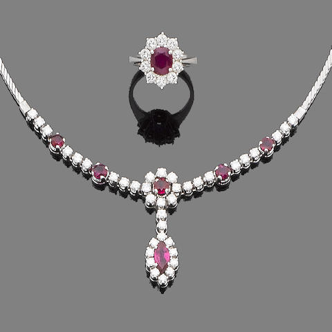 A ruby and diamond pendant necklace and ring suite (2)